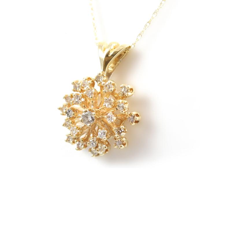 Estate 14 karat yellow gold diamond cluster pendant.