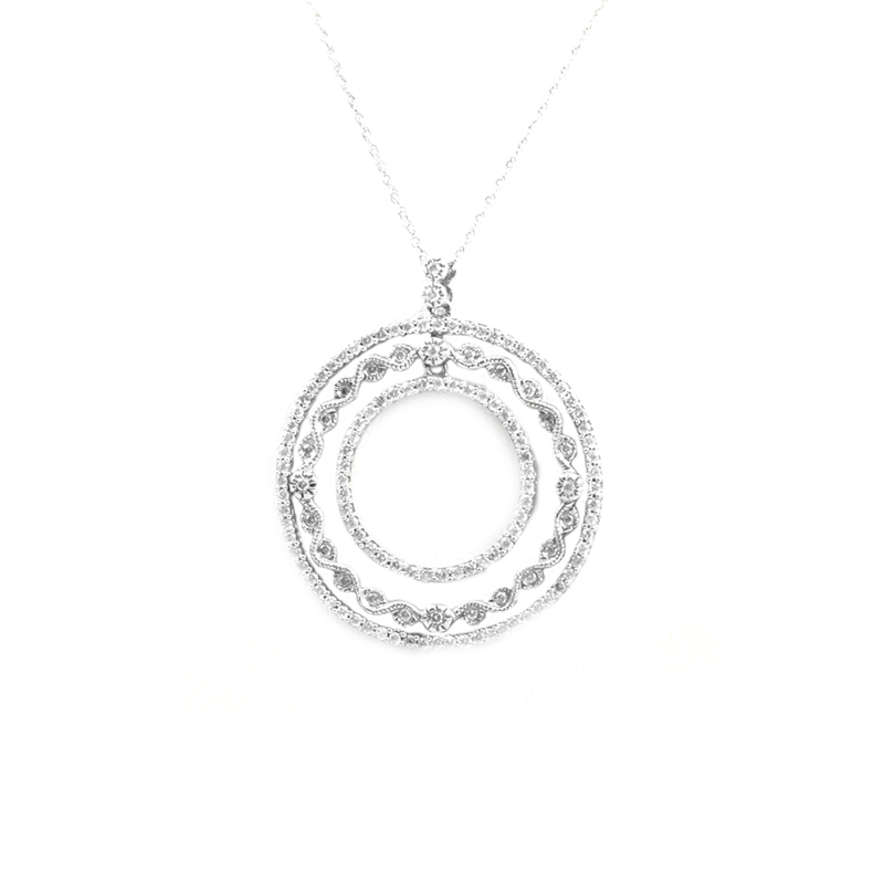 Vintage 14 Karat white gold and diamond pendant.