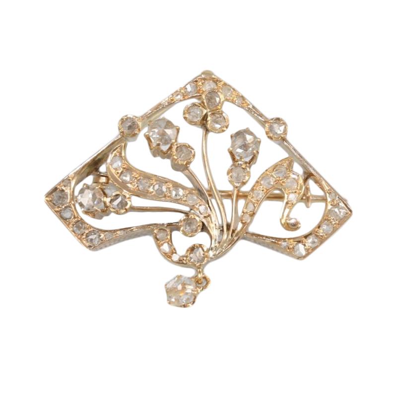 Vintage 14 Karat rose gold and diamond pin/pendant.