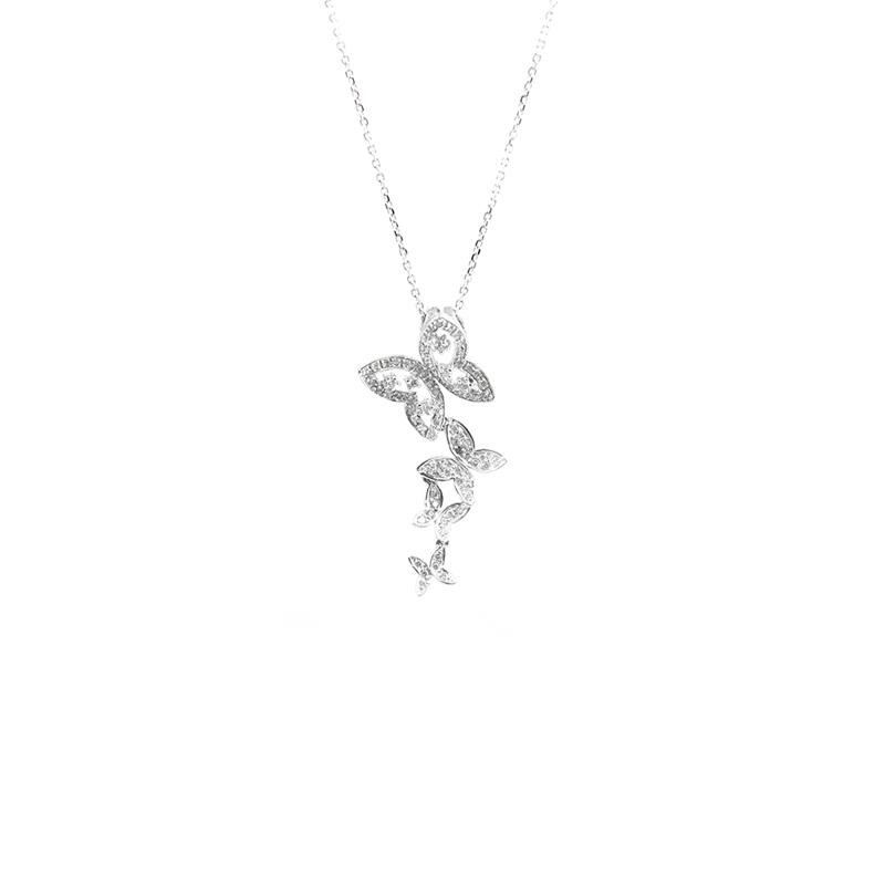Estate 18 Karat white gold and diamond butterfly pendant on a 14 Karat white gold oval link 16