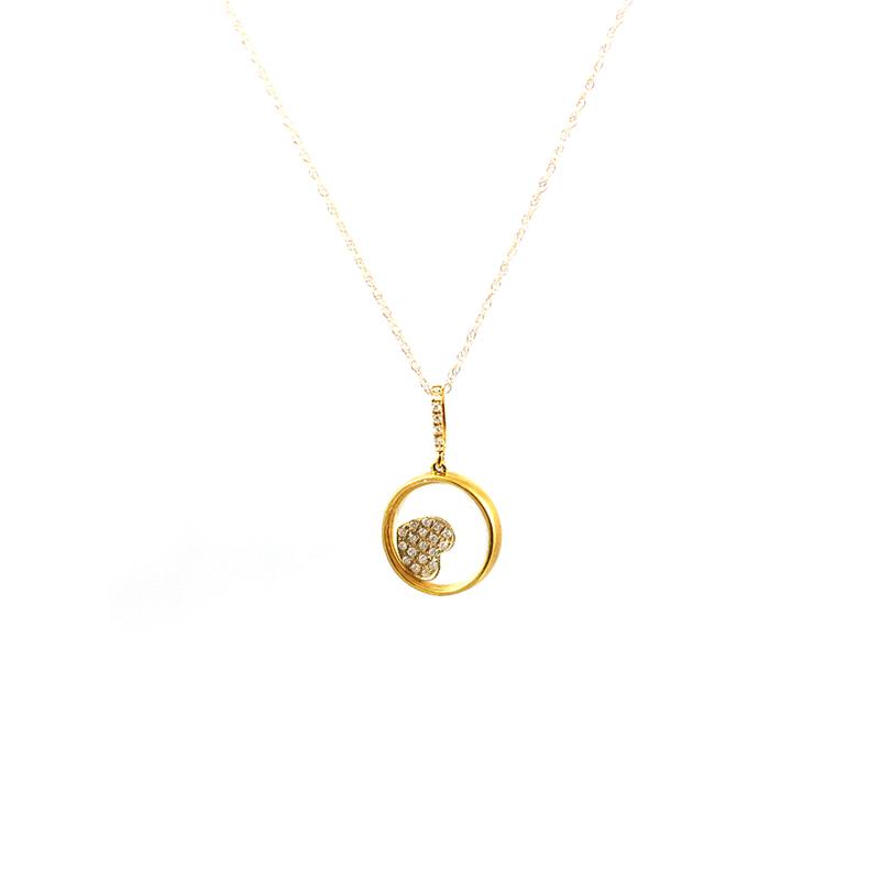 Estate 14 Karat yellow gold and diamond pendant on a 14 Karat yellow gold 18