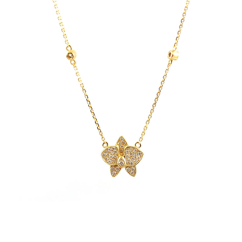 Estate 14 Karat yellow gold and diamond butterfly necklace.