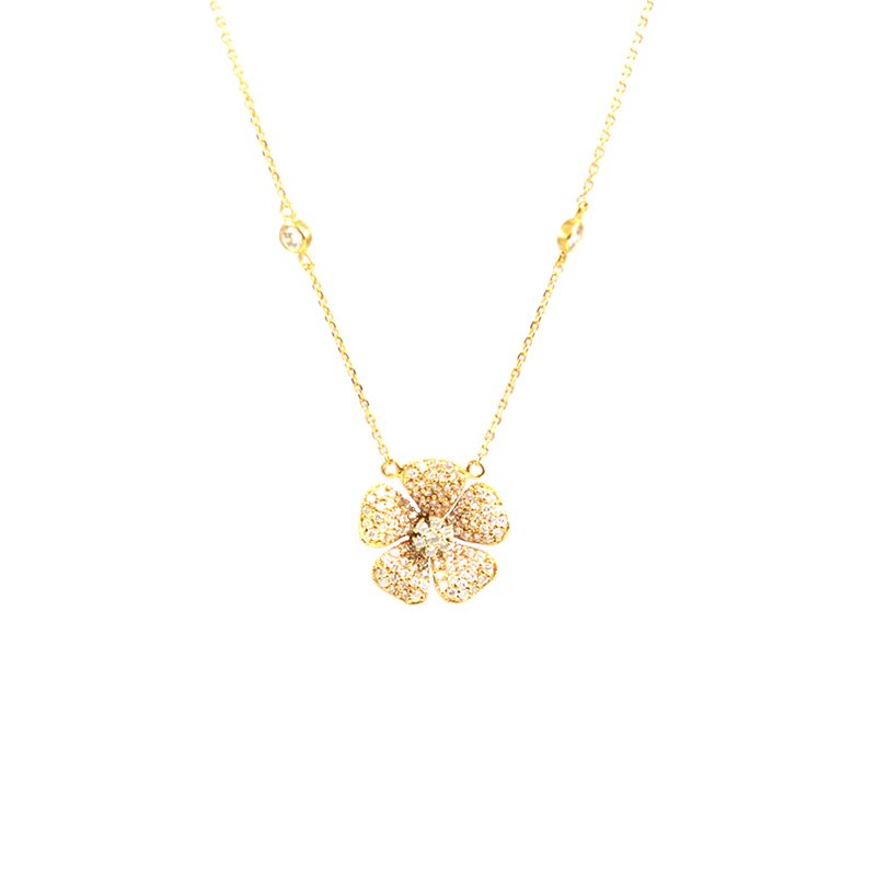 Vintage 14 Karat yellow gold and diamond flower necklace.