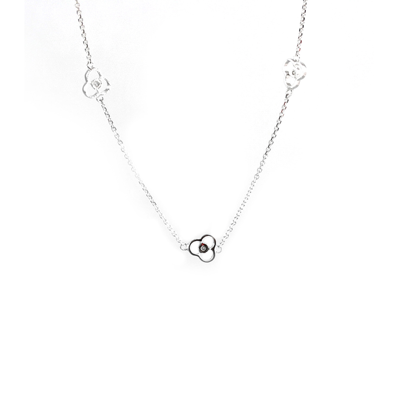 Estate 14 Karat white gold and diamond clover necklace.