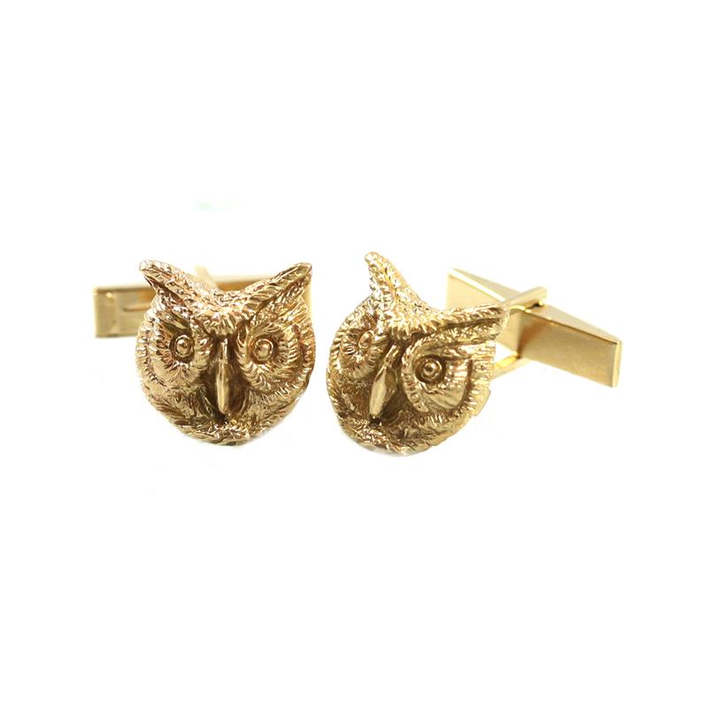 Estate 14 Karat yellow gold owl head cufflinks with ruby eyes studs set.