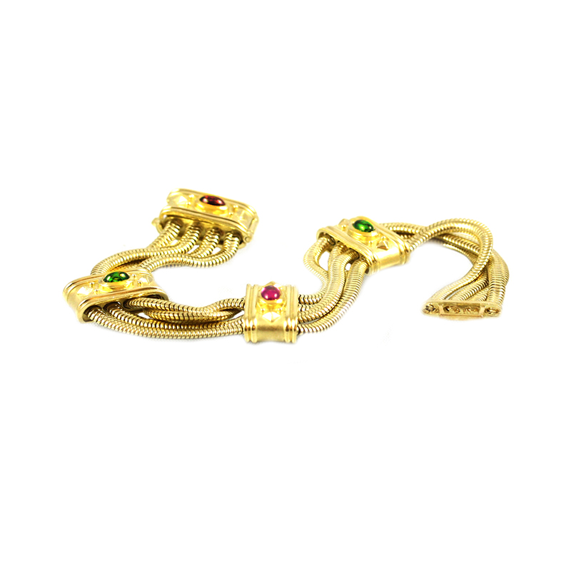 Estate Seidengang 18 Karat yellow gold, peridot, and amethyst, four strand snake bracelet.