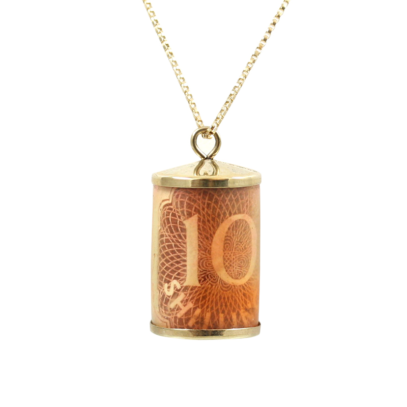 This Is A Unique 9 Karat Yellow Gold Ten Shilling English Note Charm Pendant Which Swings Graciously On A 22 Inch 10 Karat Yellow Gold Box Chain With A Lobster Clasp.