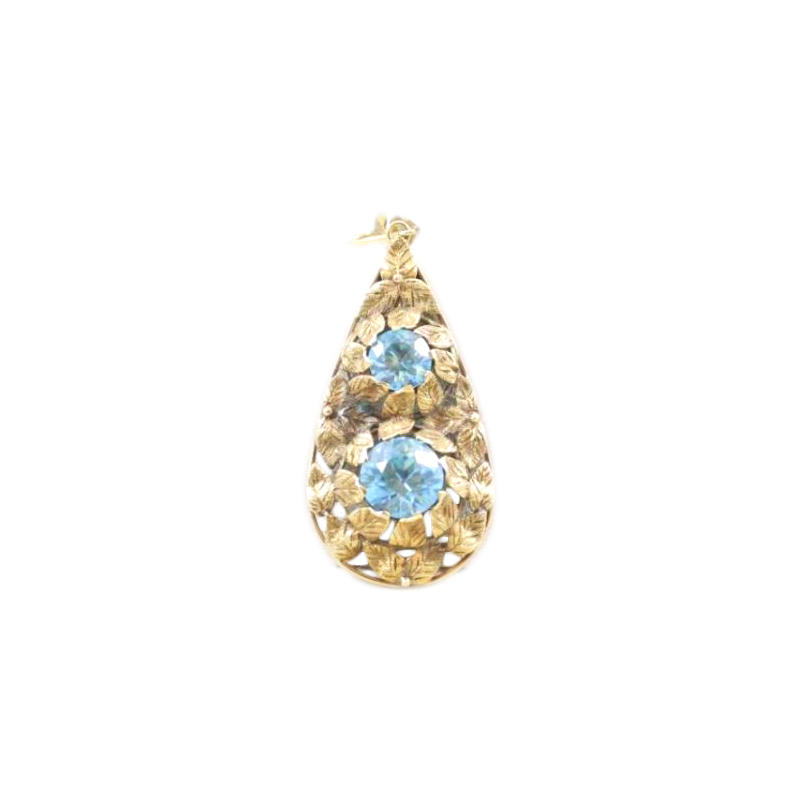 Vintage 14 Karat yellow gold pear shape blue zircon pendant.