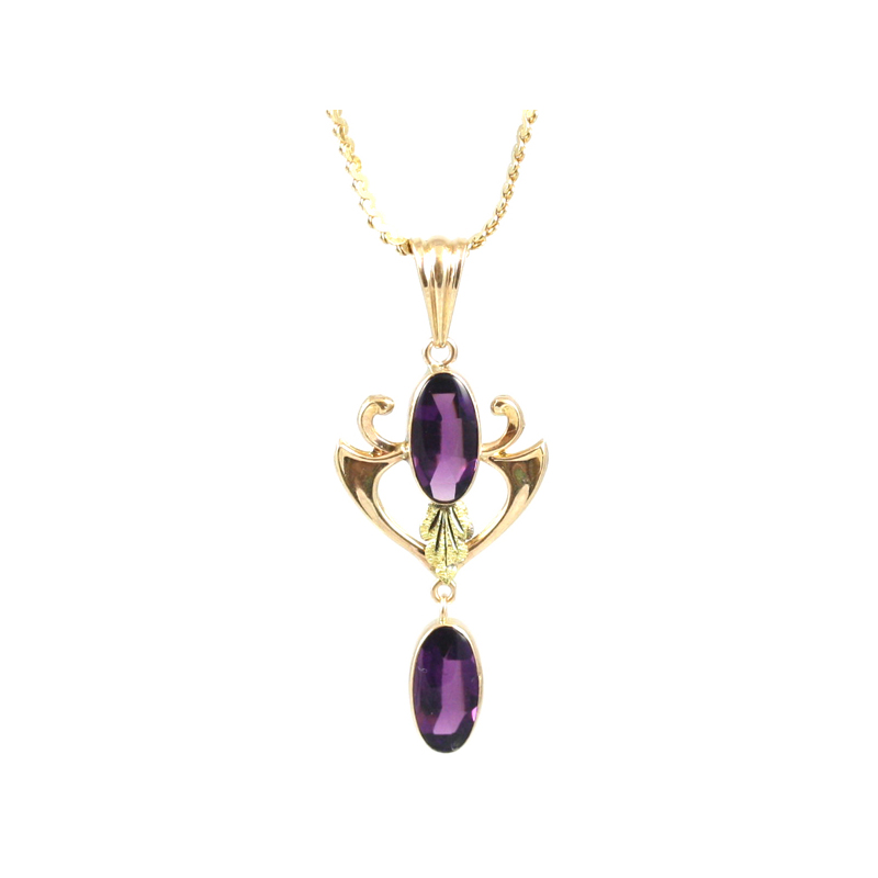 "Vintage 10 Karat yellow gold and amethyst pendant on a 14 karat yellow gold 16"" chain."