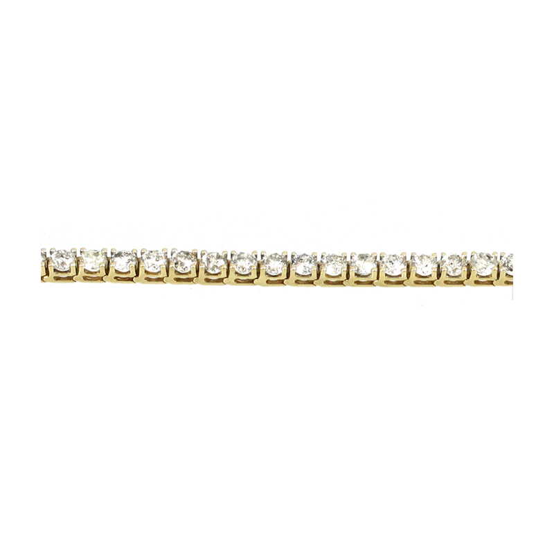 Timeless And Always In Style Is This 14 Karat Yellow Gold And Diamond Tennis Bracelet! Measuring 7 Inches Long This Bracelet Contains Thirty-Six (36) Full Cut Diamonds Each In A Four Prong Hinged Link Section.