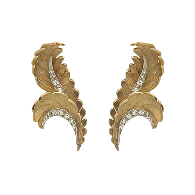 Estate 18 Karat yellow gold leaf design earrings.
