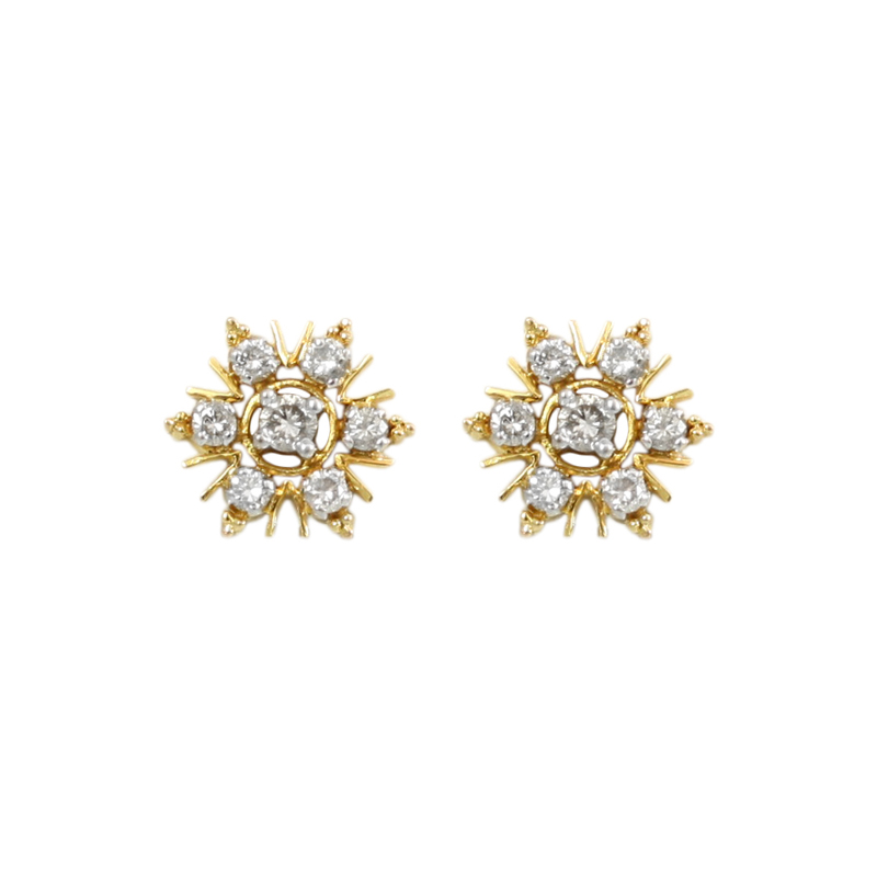 These Versatile Diamond Earrings Can Be Spring Flowers Or Winter Snowflakes! Set In 14 Karat Yellow Gold Each Earring Contains One Full Cut Diamond Prong Set In Its Center Surrounded By Six Full Cut Diamonds Prong Set.