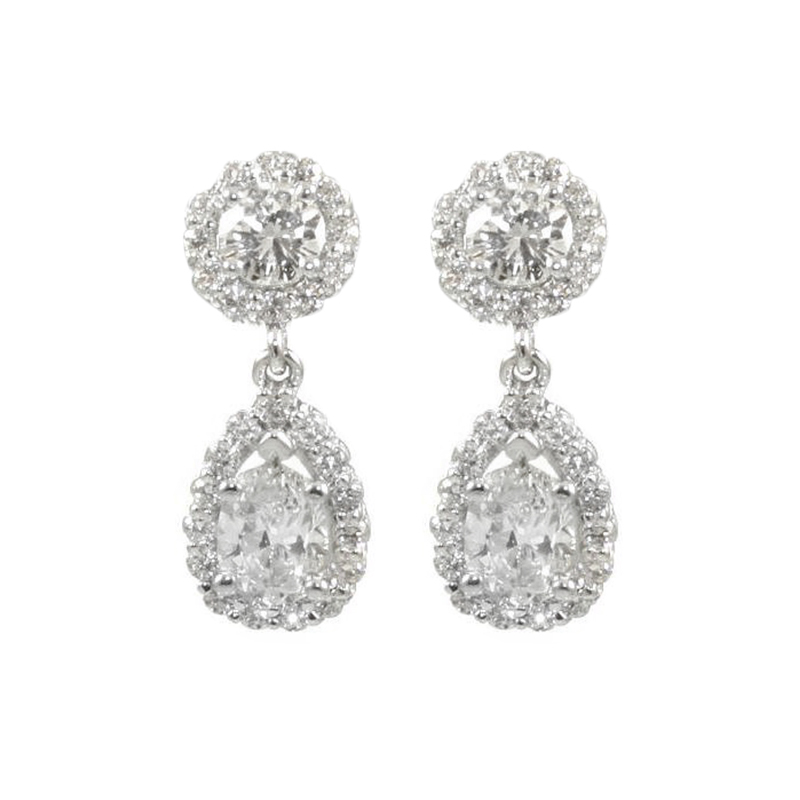 Estate 14 Karat white gold and diamond dangle earring with pierced backs.