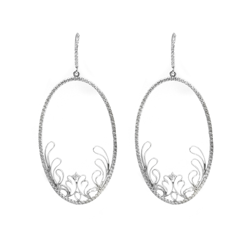 Estate 18 Karat white gold, oval diamond earring.