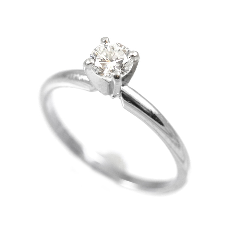 Vintage 14 Karat white gold and Platinum, diamond solitaire ring.