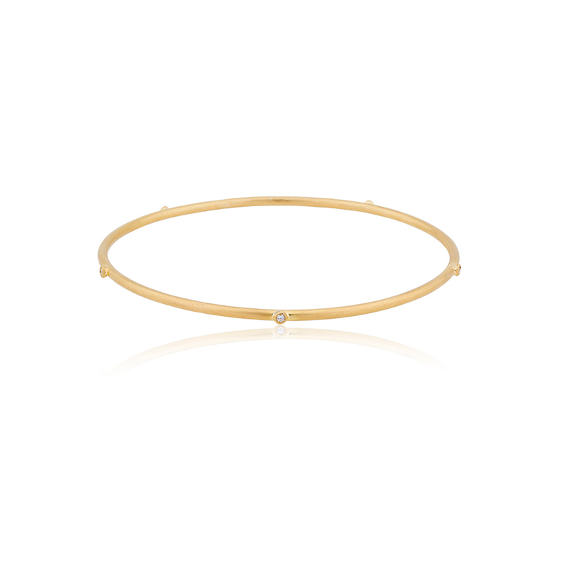 Lika Behar 22 Karat yellow gold thin bangle with diamonds.