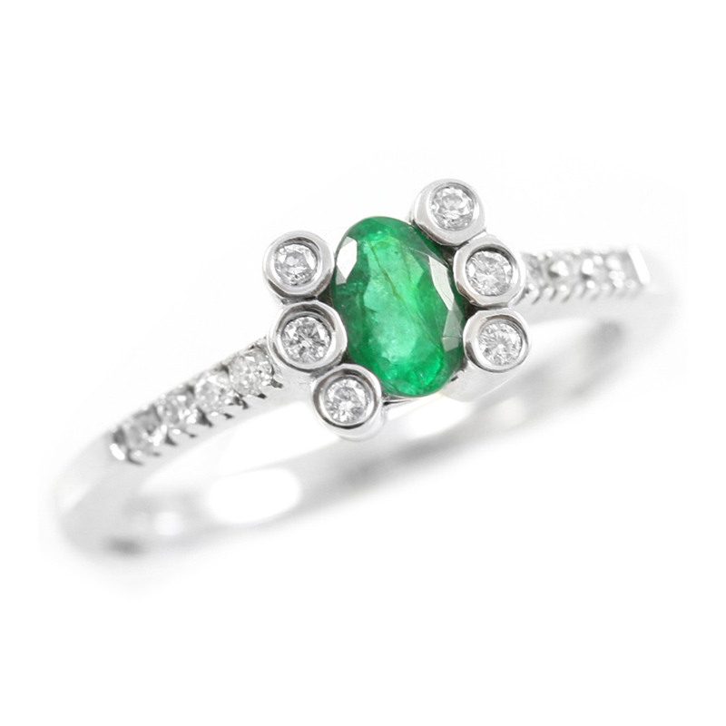 14 Karat white gold emerald and diamond ring.