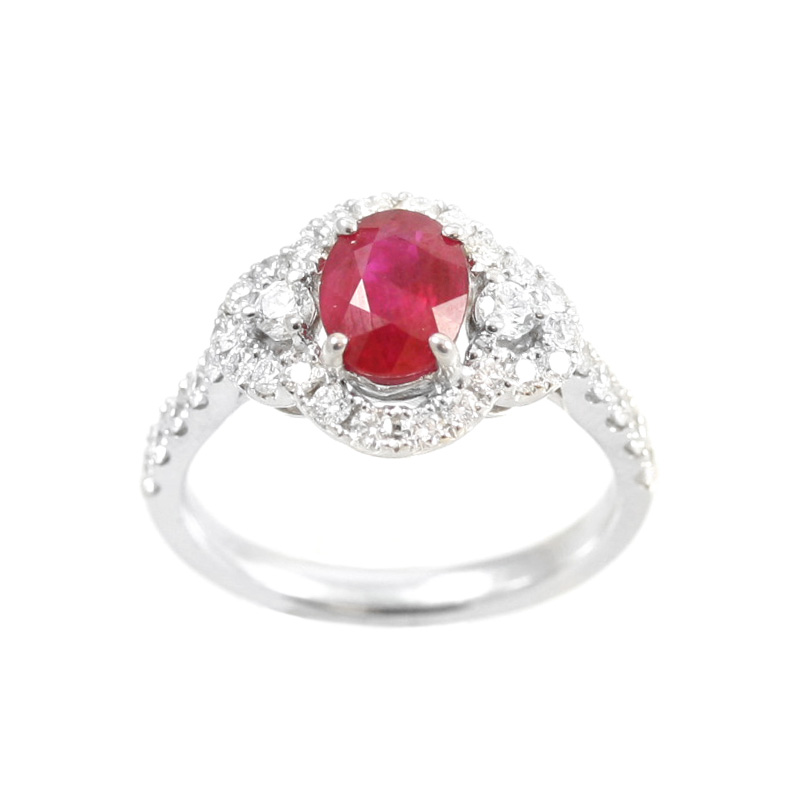 14 Karat white gold diamond and ruby ring.