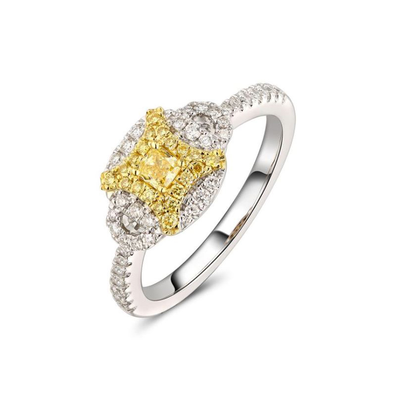 Gregg Ruth 14 Karat white gold, natural yellow and white diamond ring.