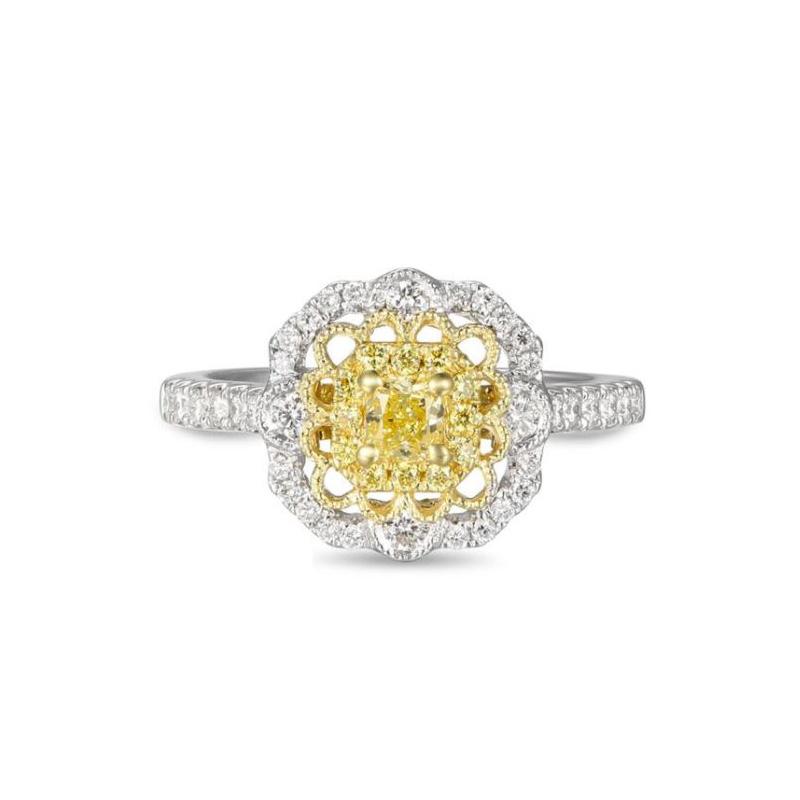 Gregg Ruth 18 Karat white gold, natural yellow and white diamond ring.