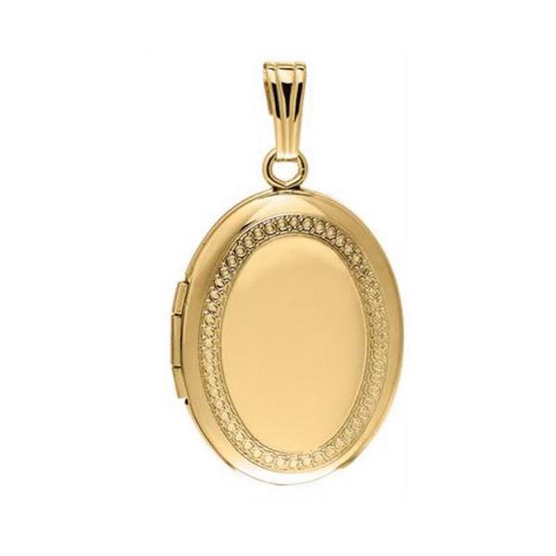 14 Karat yellow gold oval locket