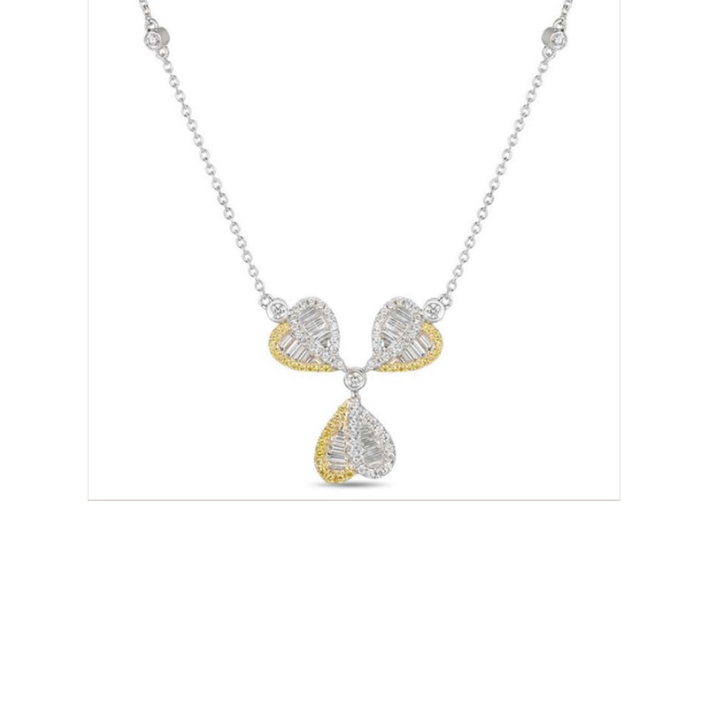"Gregg Ruth 18 Karat white gold, yellow and white diamond necklace measuring 16"" long."