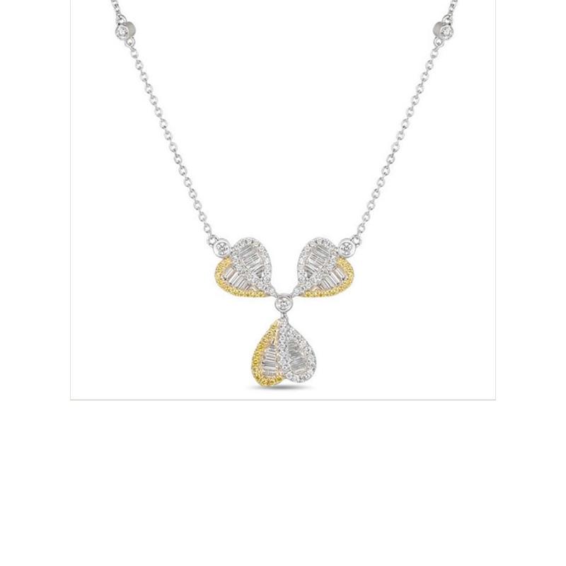 "Gregg Ruth 18 Karat white gold, yellow and white diamond necklace measuring 16"" long."