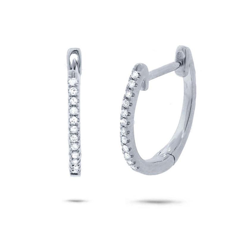 14 Karat white gold and diamond huggie hinged earrings.