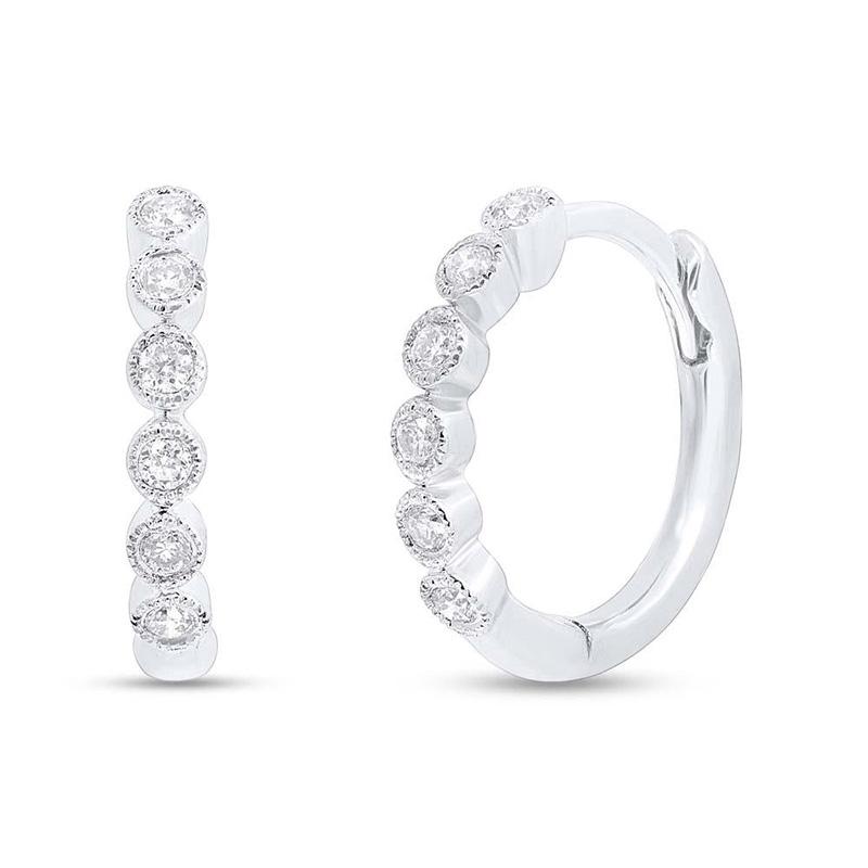 14 Karat white  gold and diamond hinged huggie earrings.