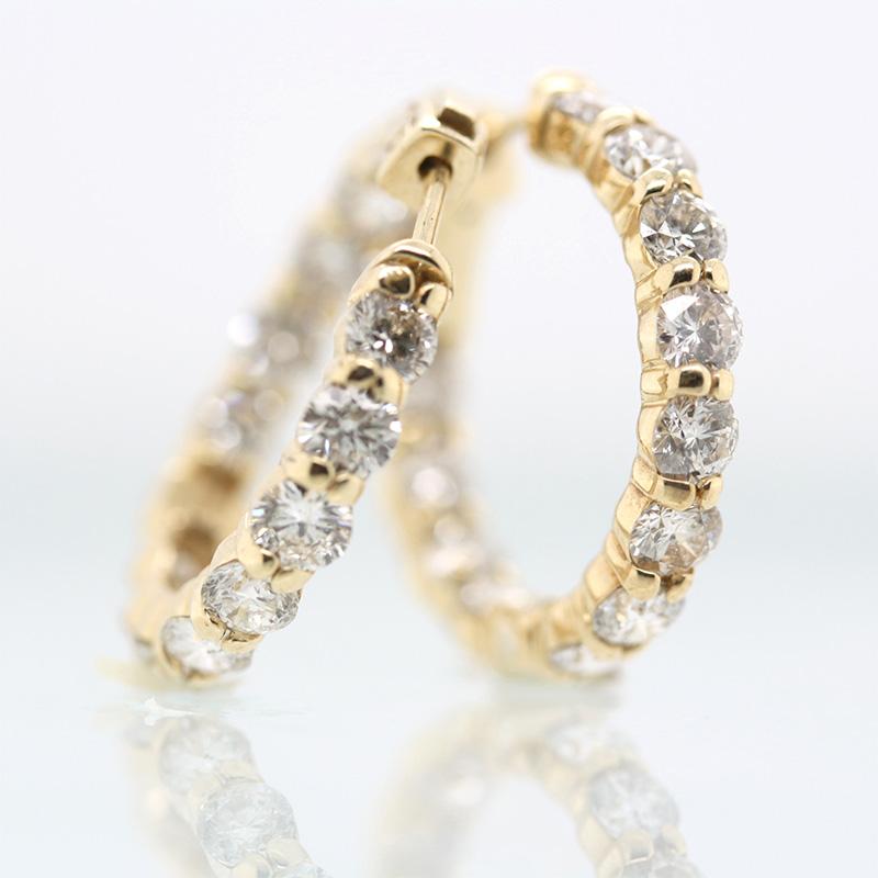 14 Karat yellow gold diamond hinged inside out hoop earrings