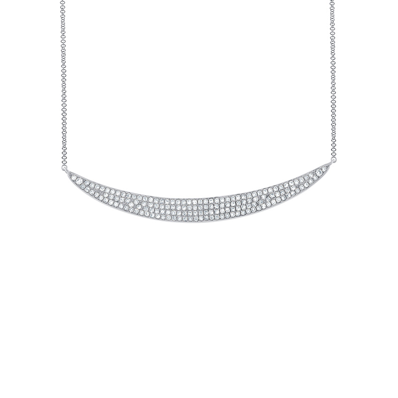14 Karat white gold and diamond crescent necklace.