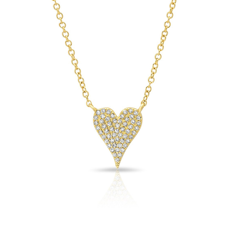 14 Karat yellow gold and diamond heart necklace suspended by a round link chain measuring 18