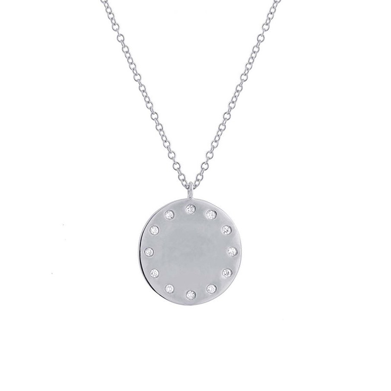 14 Karat white gold and diamond disc pendant.