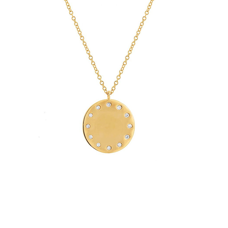 14 Karat yellow gold and diamond disc pendant.