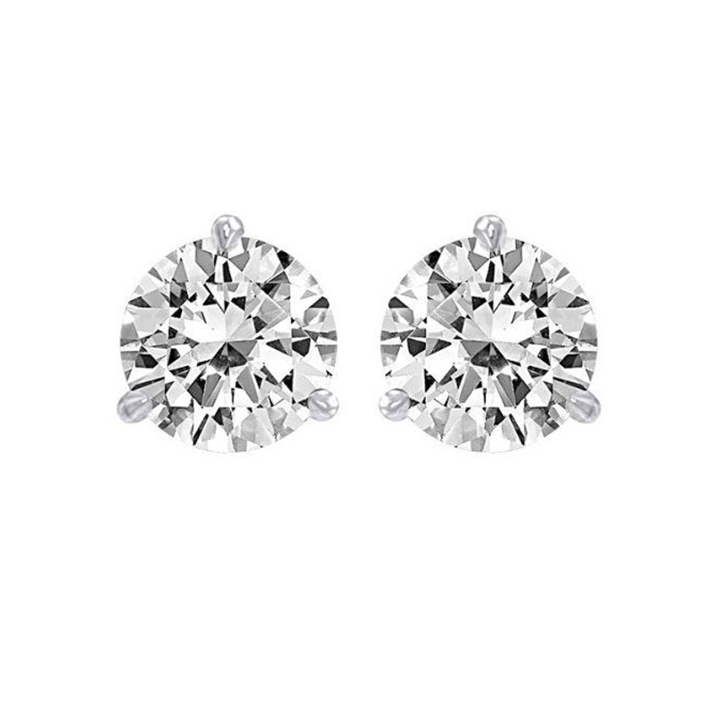14 Karat white gold diamond solitaire earring. Each earring contains one round brilliant diamond prong set.  Diamonds have a total weight of 1 carat.