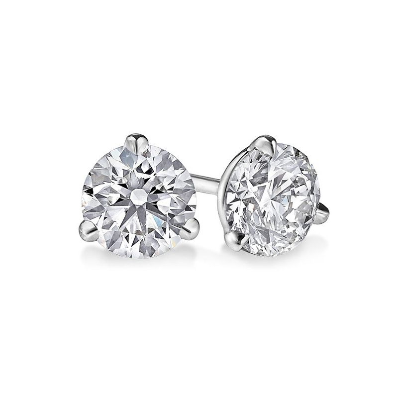 14 Karat white gold round brilliant diamond solitaire earrings in the .75 carat category program.