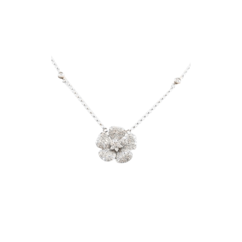 14 Karat white gold and diamond flower pendant suspended on an attached oval link chain with one full cut diamond bezel set on each side.